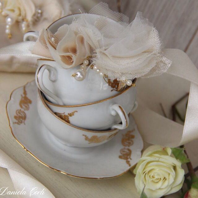 Vintage cups with handmade tulle and chiffon flowers