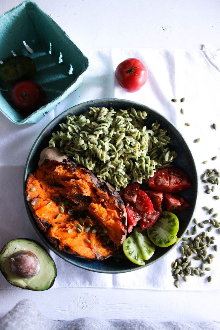 the glow bowl: baked sweet potato with pesto pasta, tomatoes + pumpkin ...