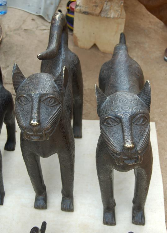 Mount these elegant Benin Bronze Leopards to guard the entryway to your home and create an aura of majesty. Over time, they weather and take on a greenish patina that adds to their allure. Alternatively, make striking focal points in any room within your home.