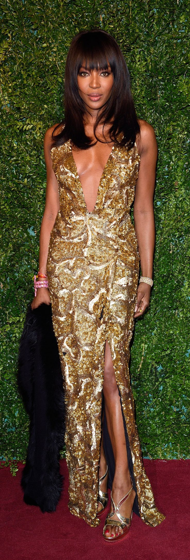 Golden gown.  Naomi Campbell never seems to age.