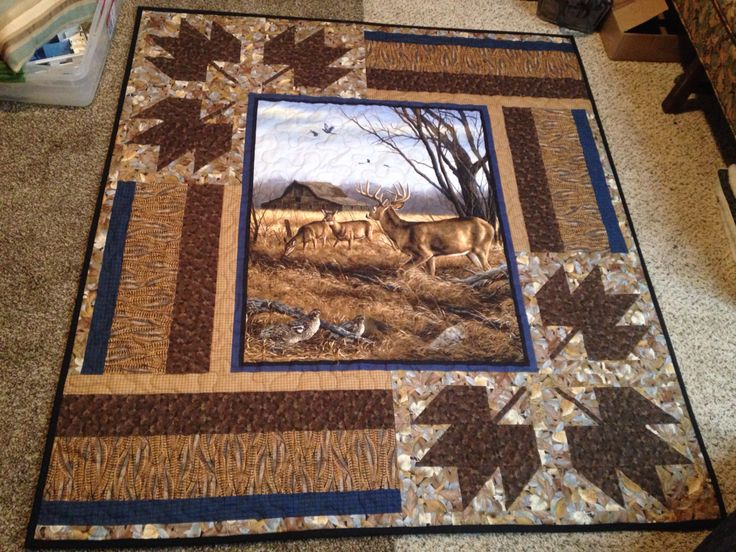 I designed the pieces borders around this beautiful deer wildlife quilt panel.