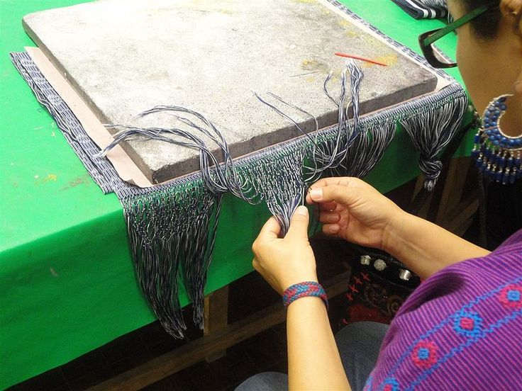 Finishing off a rebozo at a textile workshop at the Museo de Arte Popular, Mexico City