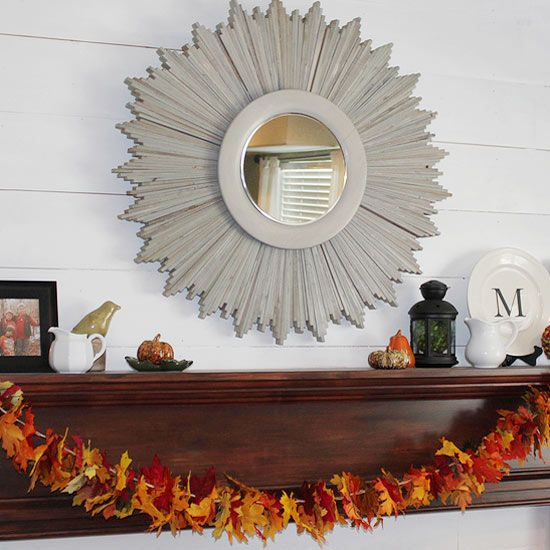 Rachael (rmhouseofnoise.blogspot.com) used several bunches of colorful fabric leaves to create a garland for her simple fall mantel. She cut the stems off and threaded the leaves together using twine and a large needle. Once her garland was hung, she added a few more formal accent pieces./