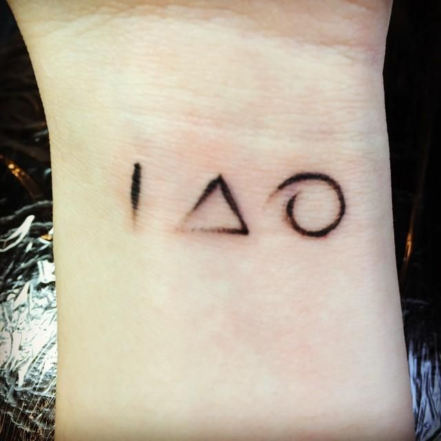Cool Deconstructed Deathly Hallows Tattoo but wand stone cape