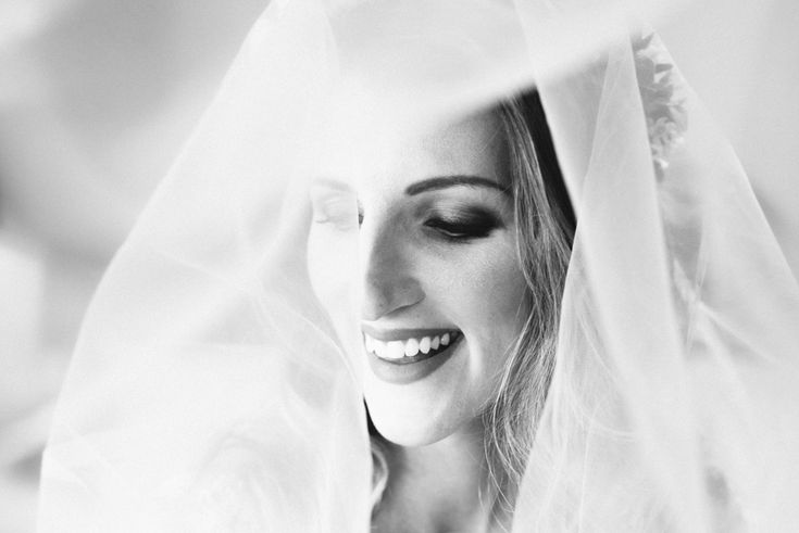 Bride under her veil in black and white