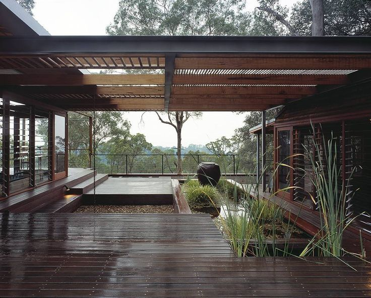 Covered deck linking different sections of the house