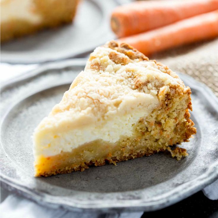 Carrot Coffee Cake | The Recipe Critic | Carrot cake meets coffee cake, and together they are a beautifully tasty concoction you won't be able to resist. A delicious carrot cake base, cream cheese center, and crumb topping.