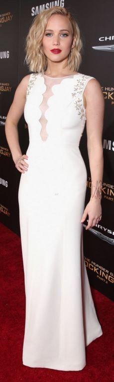 Jennifer Lawrence: Dress – Dior couture  Shoes – Jimmy Choo  Bracelet – Repossi  Rings – Graziela Gems