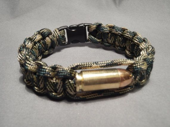 Hey, I found this really awesome Etsy listing at http://www.etsy.com/listing/126167945/paracord-bullet-bracelet-40-sw-woodland