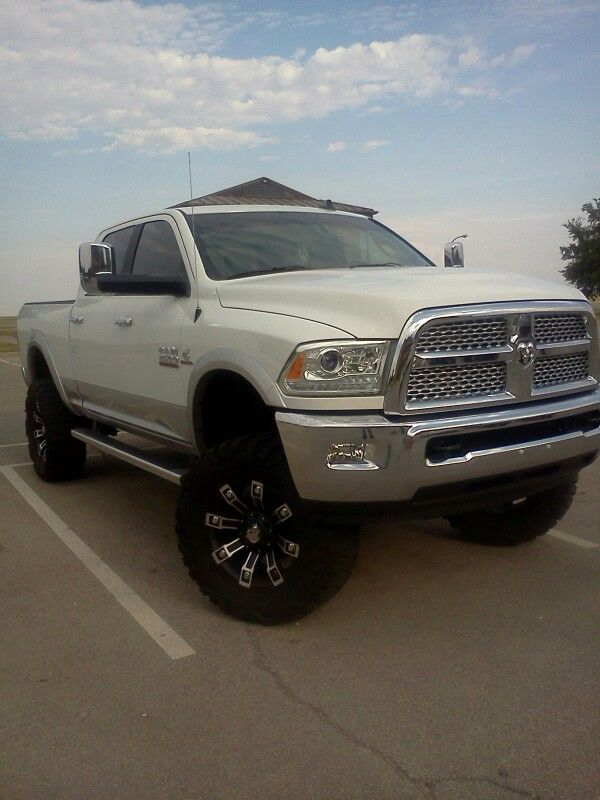 2013 white dodge ram 2500 cummins lifted jacked up