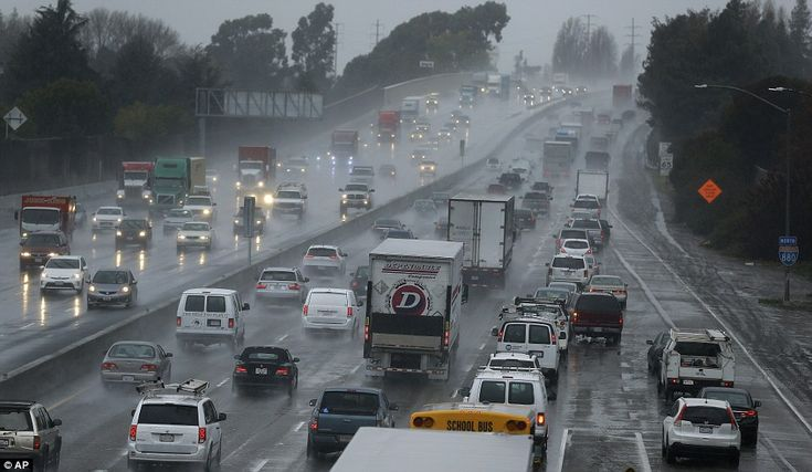 Vehicles slow on Interstate 80 during a winter rain storm in San Leandro, California. Forecasters are predicting the worst is still to come   5 January 2016