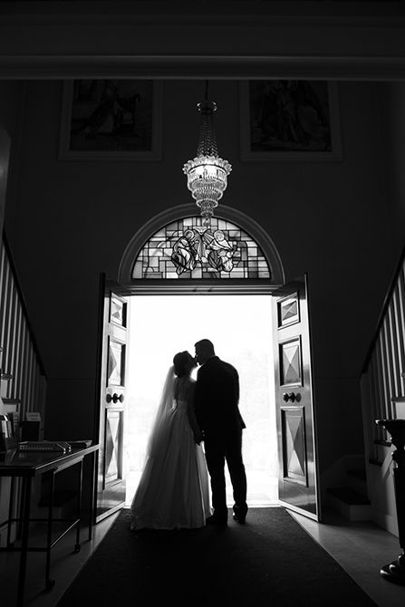 A beautiful silhouette upon exiting the church and stepping out into the world as husband and wife #markjayphotography #sydneyweddingphotographer #weddingphotography #bride #groom #pose