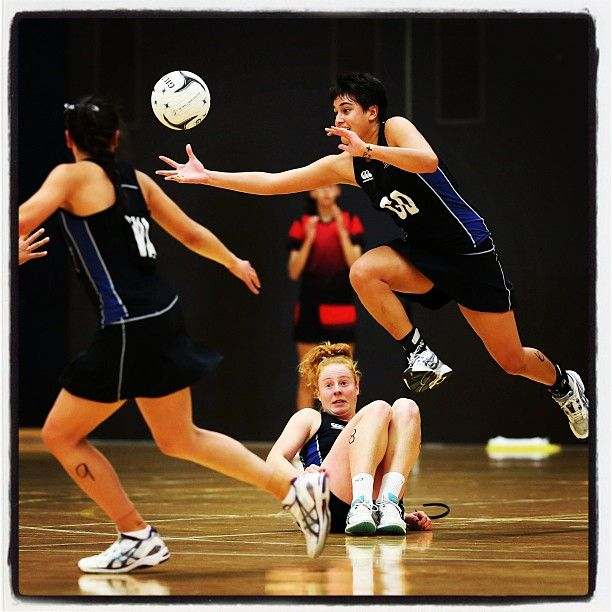 Shot of the day! Sam Simclair looks on at Fa'amu Ross as she soars (c) Mbphotonz  - Photo by netballnewzealand