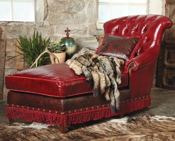 Luxurious red leather with Italian tooled red leather highlights, red suede welting and hand-twisted leather fringe all around