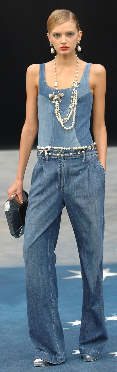 Pearl jewelry always gives a final touch... Chanel. What a stylish look - denim with pearls...