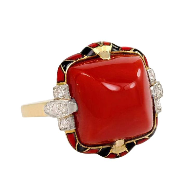An Art Deco coral ring with red and black enamel decoration and diamond accents, in 14k gold and platinum. Signed FFF.Circa 1925s