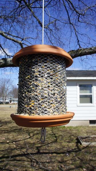"""what a fabulous use for """"gutter guard"""" mesh ~ the hardest part of this DIY is drilling holes for the wire that's strung through the middle of the saucers"""