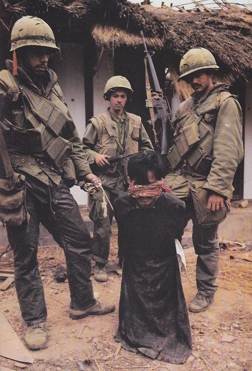 Marines with a villager ready for interrogation. ~ Vietnam War