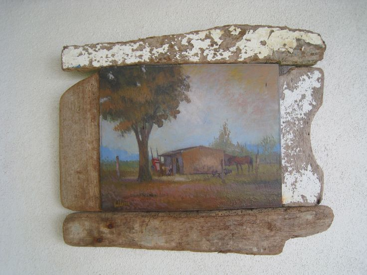 an old picture framed with driftwood