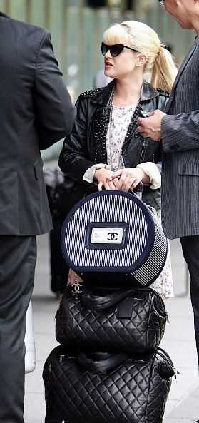 """""""Chanel Train Case and her Chanel Cocoon luggage are both modern and totally classic. Kelly's look may change again, but her luggage will look great forever."""""""