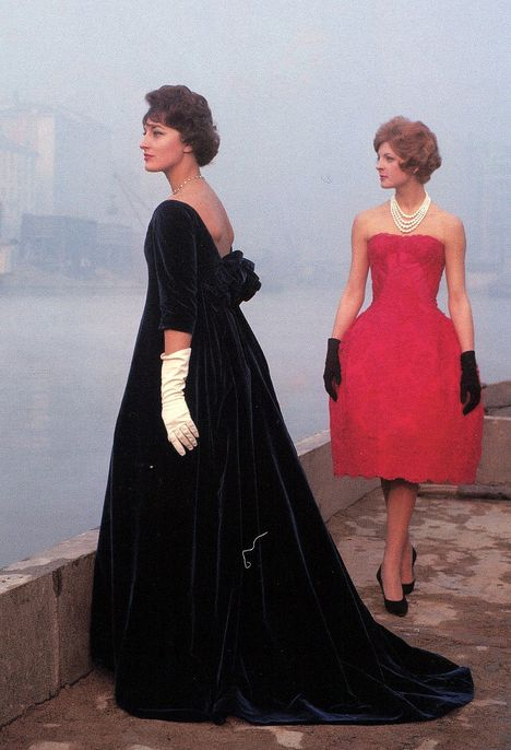 Models in evening gowns, Milan 1958. Mirella Pettini in red along the Navigli, Photo by Ugo Mulas.