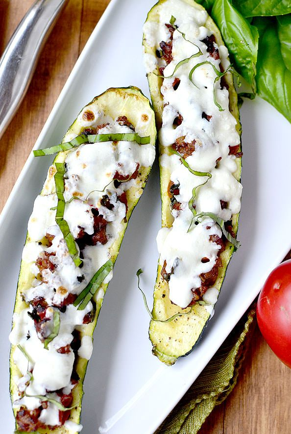Italian Tomato-Basil Stuffed Zucchini is a light, low-carb, gluten-free summer dinner. Easy and so satisfying! | iowagirleats.com