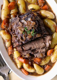 3-4 lb. (1.5-2 kg) chuck roast, rump roast, boneless bottom or eye of round or brisket salt and freshly ground black pepper canola or olive oil, for cooking?1 onion, peeled, halved and thinly sliced 3-4 garlic cloves, crushed or chopped 3-4 cups beef, onion or chicken stock 1 cup red wine (optional) 1 Tbsp. balsamic vinegar a couple sprigs of fresh thyme or rosemary (or both) 2 carrots, peeled and cut into 1-inch pieces 8-12 new or fingerling potatoes Preheat the oven to 300F. Season the…