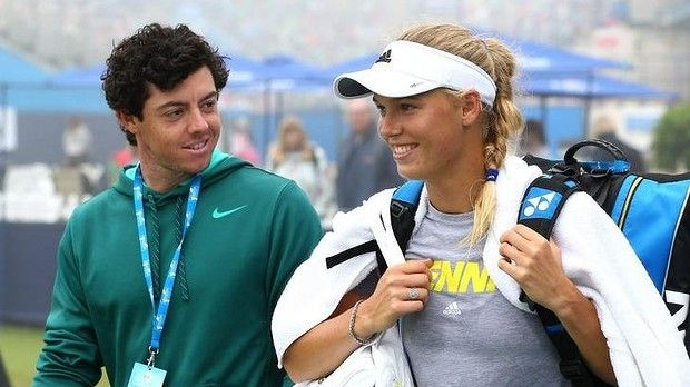 Juggling careers: Rory McIlroy and Caroline Wozniacki at the Eastbourne tennis tournament last year. McIIroy recently called off his wedding with Wozniacki.