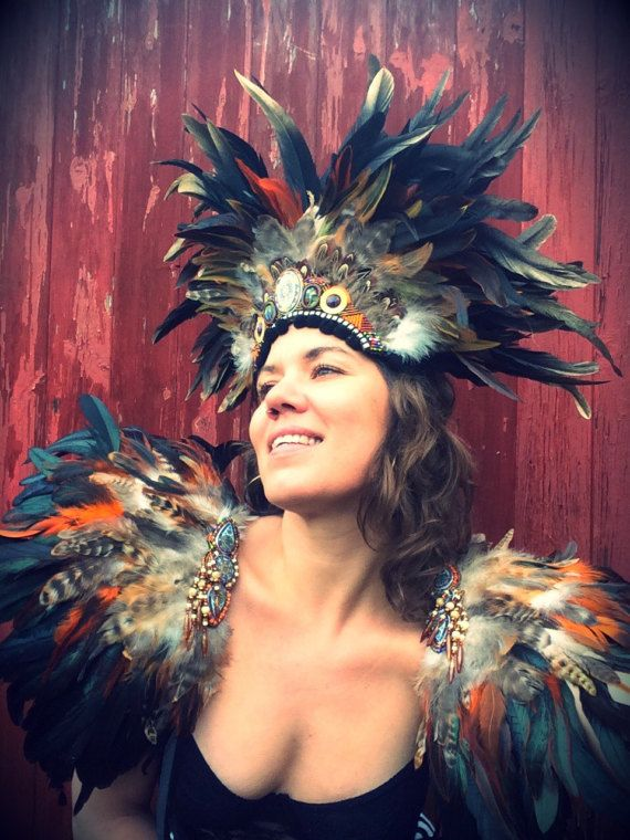 Mad Max inspired feather festival headdress and matching feather shoulderpieces. Burning Man vibes. Shop the look www.wildthing.com and https://www.etsy.com/uk/shop/feathersandthreaduk