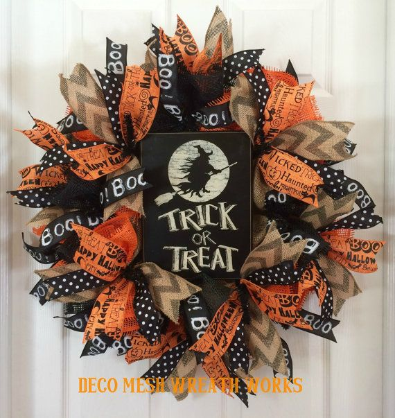 Happy Halloween and Trick or Treat!  This adorable wreath is made on a 24-inch black work wreath frame with burlap fabric and black and