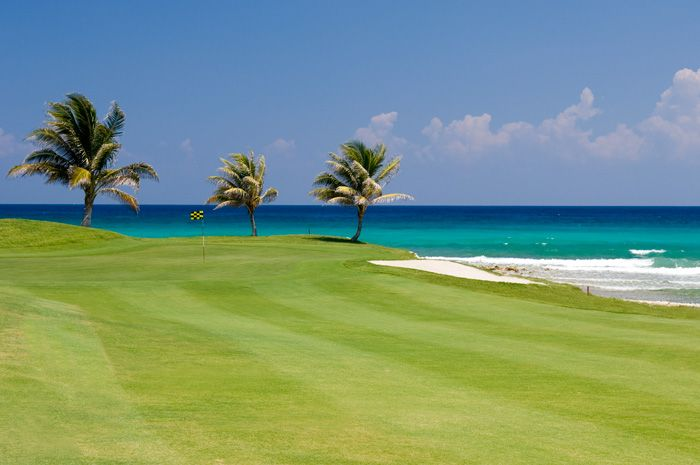 Breathtaking view while golfing - this is every golfer's dream. Golfing at Cinnamon Hill in Jamaica. Things to do in Montego Bay Jamaica. #Jamaica #Golf #Vacation