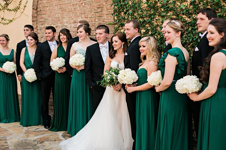 Gorgeous emerald green bridesmaid gowns. Perfect for this holiday inspired wedding.