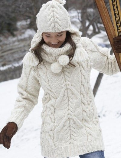 Big Aran Sweater and Earflap Hat - Free pattern | Yarnspirations - Chunky long white sweater with fun collar and Aran-inspired cables. Matching hat w/ earflaps.