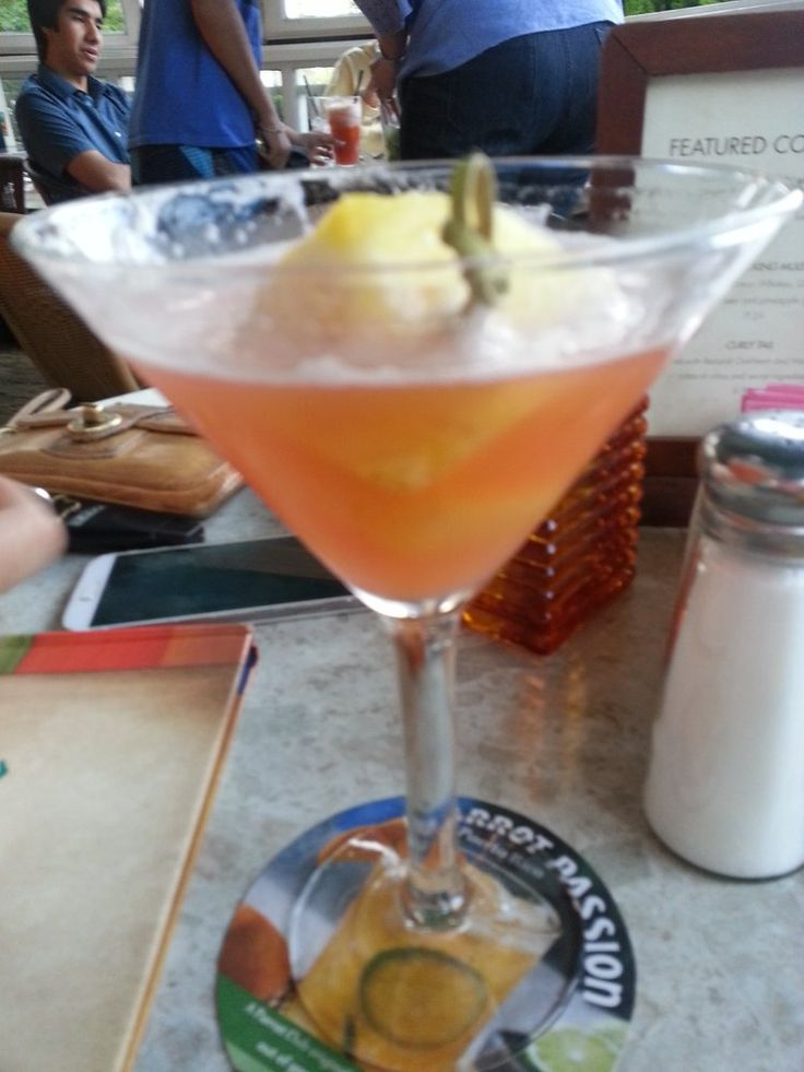 COCONUT PINEAPPLE MARTINI  Bahama Breeze Restaurant Recipe   2 oz Captain Morgan's Parrot Bay Coconut Rum  2 oz Pineapple Juice  Splash o...