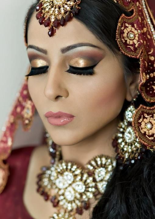 Indian bride makeup other then her very obvious fake eyelashes her makeup is stunning!!