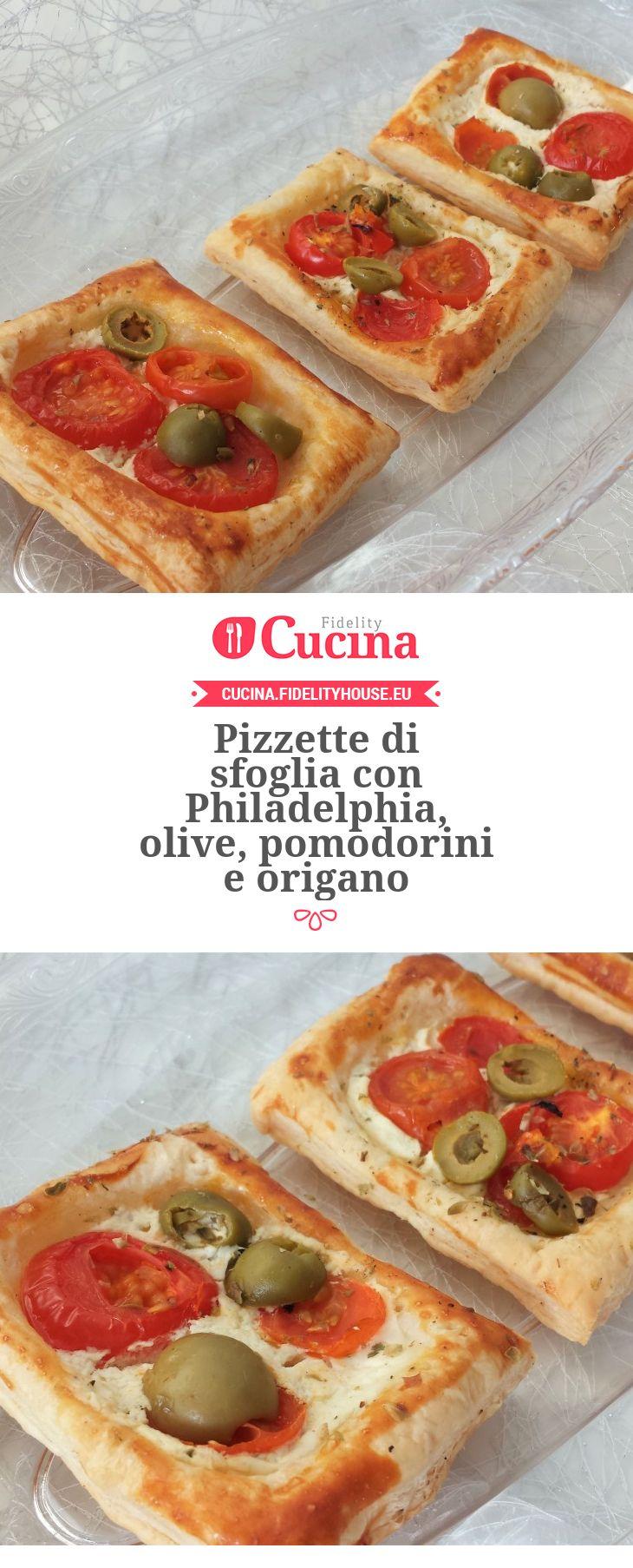 Pizzette di sfoglia con Philadelphia, olive, pomodorini e origano della nostra utente Giada. Unisciti alla nostra Community ed invia le tue ricette!