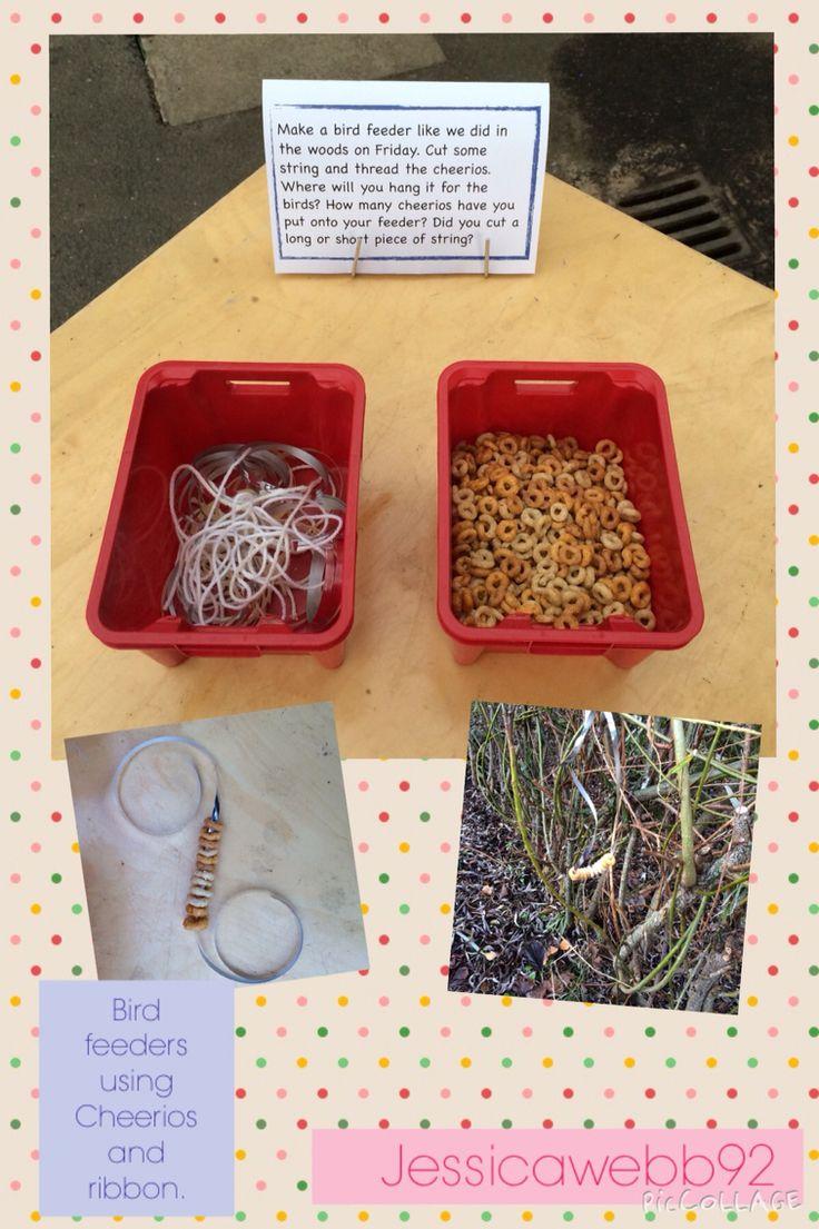 Making bird feeders using Cheerios and ribbon. EYFS