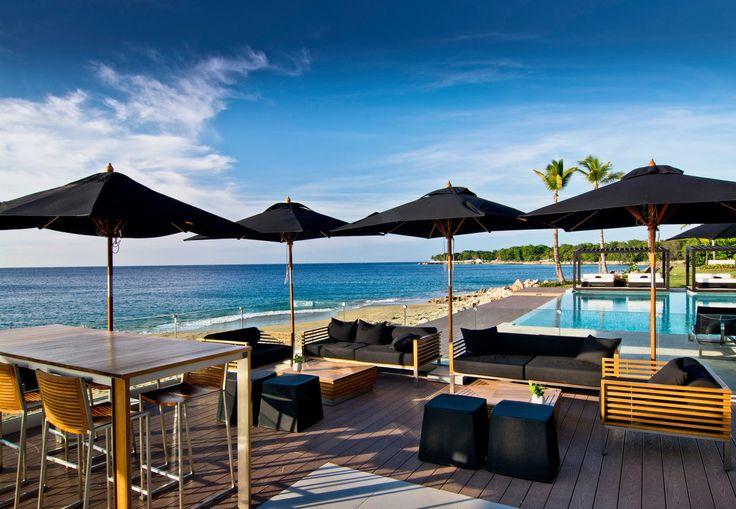 Gansevoort Dominican Republic Sosua, Caribbean Beachfront Deck Dining Luxury Pool umbrella sky chair water leisure lawn Resort swimming pool set dock Sea empty shore lined day