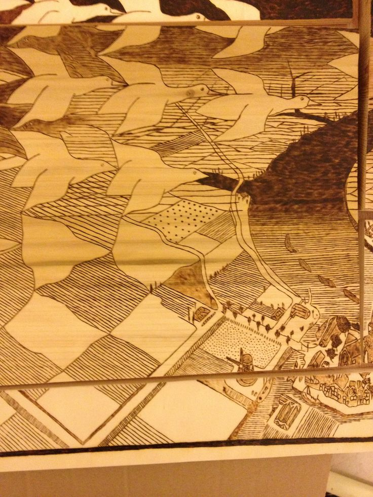"""Pyrography work, 40x70 cm Based on """"Day and Night"""" by M.C. Escher Used 5 types of wood (playing on their natural color): 1. Poplar wood - the middle  2. Beech wood - the bottom left 3. Oak wood - the top right 4. Poplar plywood - all other visible parts 5. Okoume plywood - all the parts were glued on the back to one piece of plywood (you can see it between the pieces)  The angles were on purpose not straight lines, and the woods are not the same depth giving the work a 3D look.  The…"""