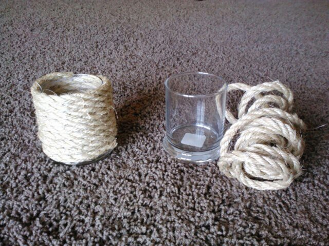 Rope wrapped glasses for nautical bathroom. Toothbrush and toothpaste holders. $8 for 50' of rope at Lowes and the glasses were $1 a piece at the dollar store.