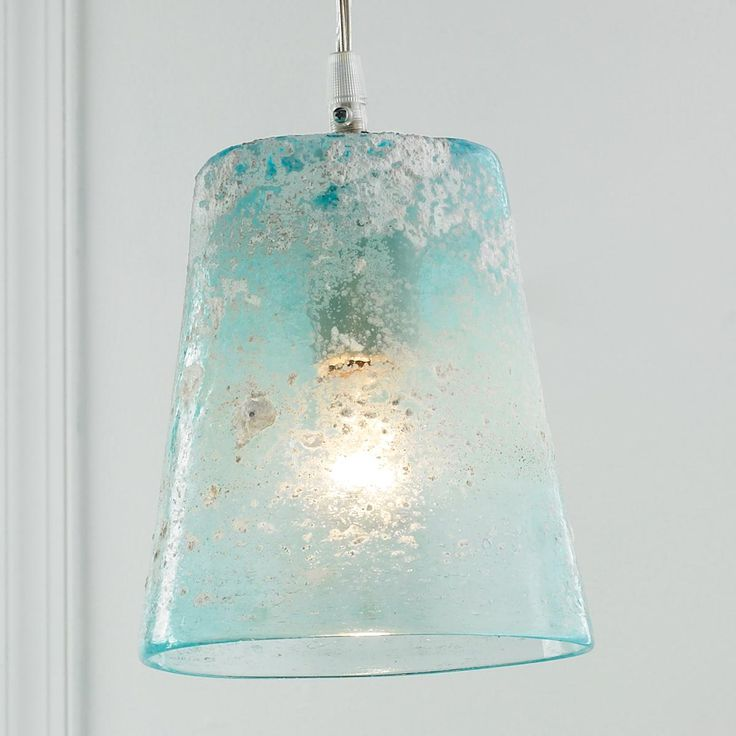 "Sand Frost Glass Pendant Light The call of the sea echoes in this white ""sand"" crusted sea glass pendant light in a soft aqua color. 60 watts medium socket. (8.5""Hx6.25""W) 9' clear cord"