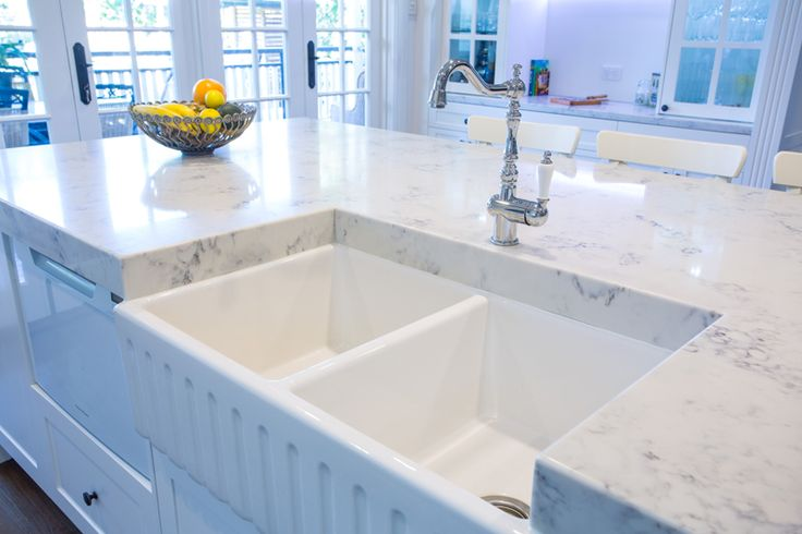 Double bowl belfast sink with traditional tap is a feature in island bench