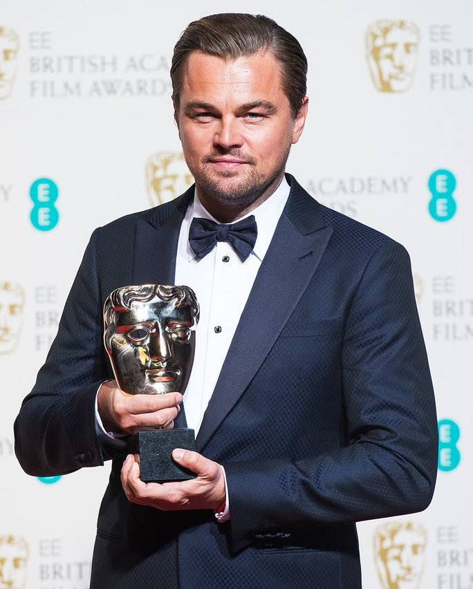 BAFTA Winner Leonardo DiCaprio Plants a Wet One on the Awards Show Kiss Cam—See the Lucky Lady!