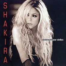 """""""Underneath Your Clothes"""" is a power ballad by Colombian singer-songwriter Shakira - the second English language single released from Laundry Service (2001). It is a love song with lyrics by Shakira and music by her and Lester Mendez and tells the story of the unconditional love that a woman has for her boyfriend, which is referenced in the lyrics"""