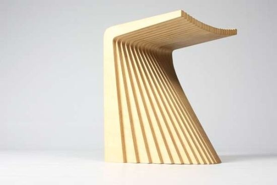 Fan Chair. Chris Hardy. Assembled with L-shaped cuts of plywood, each piece differs slightly from the adjacent, gradually forming a parabolic skirt and contoured platform.