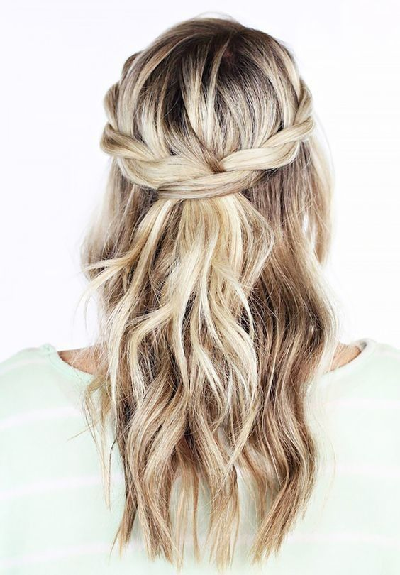 Don't you love the twisted braid crown and waves? It's a great look for a non-traditional boho bride.Image via Pinterest