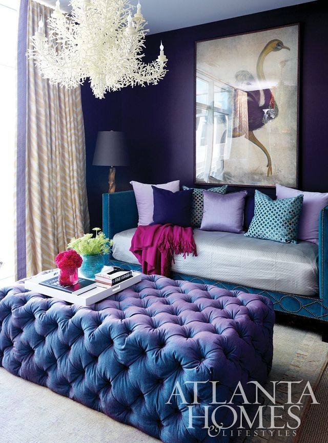 Royal purple walls and tufted ottoman makes this a signature living room — Color Exploration: Paint it Peacock! — Spectacular Design Interiors