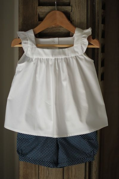 darling little girl outfit. (am imagining it with a big ole' navy bow) shorts still scare me, though even though these are just precious.