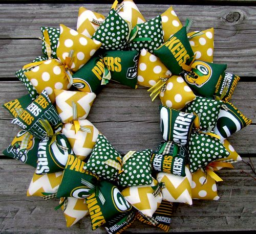 Calling all Green Bay Packers fans!!! This decorative handmade wreath is for you. Loaded with the Packers colors of green and yellow and white, this SooBoo Designs wreath is perfect to display all y