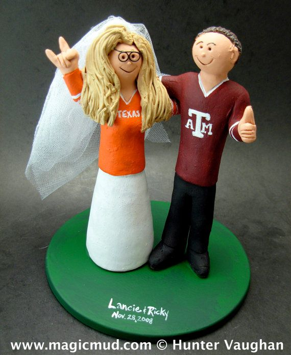 Texas Aggies A&M Football Wedding CakeTopper, Football Wedding Anniversary Gift/Cake Topper, NFL Football Wedding CakeTopper,NCAA Caketopper    Football Wedding Anniversary Gift/Cake Topper, NFL Football Wedding CakeTopper, NCAA Caketopper  ...a fired clay Wedding Cake Topper for a Football Fan's Marriage, custom created for you! Handmade to your specifications by magicmud.com    $235 #magicmud 1 800 231 9814 www.magicmud.com